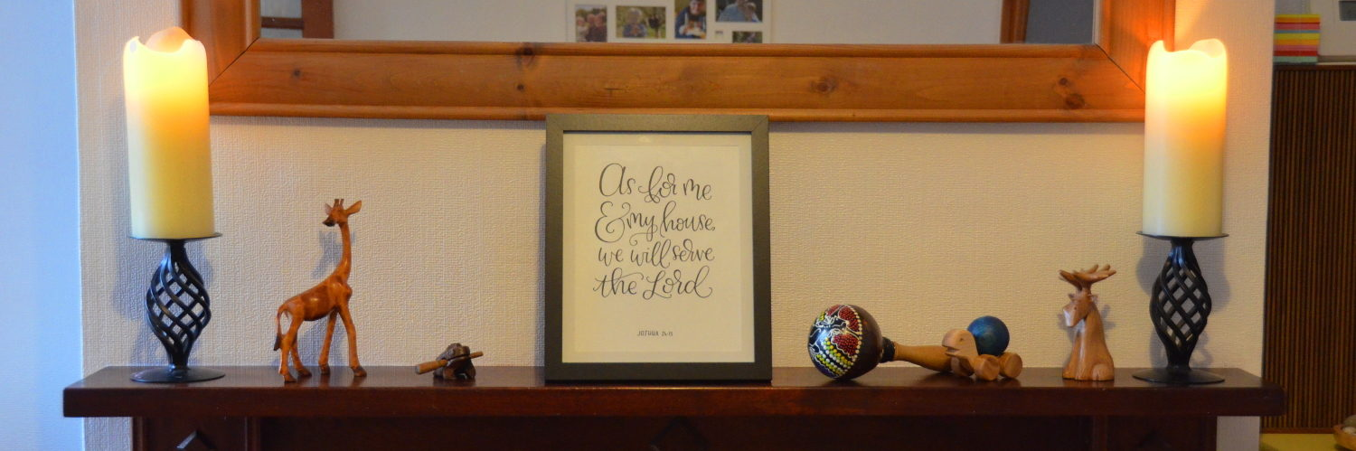 "Mantelpiece with a bible verse of ""as for me and my house, we will serve the Lord"""